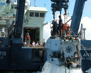 Gulf of Alaska Seamount Expedition. ALVIN being lifted onto the deck of WHOI R/V ATLANTIS by the A-frame, with swimmers Bruce Strickrott and Sean McPeak (Chief ALVIN pilot and electronics technician respectively) working the recovery.
